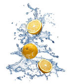 Orange fruit and water splash — Stockfoto