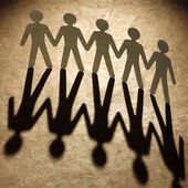 Group of paper people holding hands. — Stock Photo