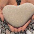 Hands holding a heart-shaped stone — Stock Photo #47864259