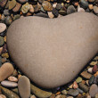 A heart-shaped stone — Stock Photo