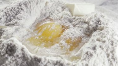 Butter and eggs on flour — Stock Video