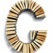Letter G formed from the page ends of books — Stock Photo