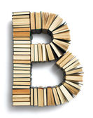 Letter B formed from the page ends of books — Stock Photo