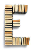 Letter E formed from the page ends of books — Stock Photo