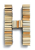Letter H formed from the page ends of books — Stock Photo
