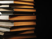 Books in shadow — Stock Photo