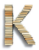 Letter K formed from books — Stock Photo