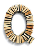 Letter Q formed from books — Stock Photo