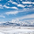 Panoramic landscape of snowy mountains in the spring — Stock Photo #23046916