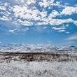 Panoramic landscape of snowy mountains in the spring — Stock Photo #23047048