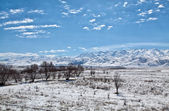 Panoramic landscape of snowy mountains in the spring — Stock Photo