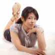 Asian girl in a studio on carpet - Foto Stock