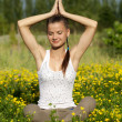 Portrait of a girl in the flower meadow. Woman meditating — Stock Photo