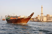 The bows of traditional wooden trading dhows moored in Dubai Creek, UAE. — Stock Photo