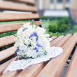 Wedding bouquet of flowers on a bench — Stock Photo
