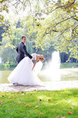 Happy young bride and groom — Stock Photo