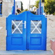 Royalty-Free Stock Photo: Greek traditional white walls and blue door in one of the small villages, Cyclades, Greece