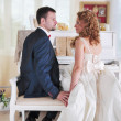 Happy married couple near the piano — Stock Photo