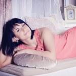 Brunette woman lying on the sofa — Stock Photo #42791465