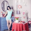 Woman standing in romantic kitchen interior — Foto de Stock