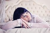 Beautiful girl in bed — Stock Photo