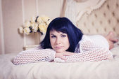 Young elegant woman in bed — Stock Photo