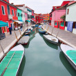 BURANO, ITALY - November 8: Canal with colorful houses on the famous island Burano, Venice on November 8, 2013 in Burano. — Stock Photo #46418215