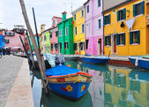 Burano island canal, colorful houses church and bBURANO, ITALY - NOVEMBER 8: canal with colorful houses on the famous island Burano, Venice on November 8, 2013 in Burano.oats, Italy. — Stock Photo