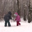 Stock Video: Children throw snow