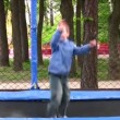 Child on trampoline - Stock Photo