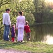 Family on spring pond — Stock Video