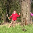 Children run around tree — Stock Video #12283547