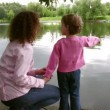 Mother with little girl on pond — Stock Video