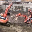 Three excavators, no logos - Stock Photo