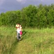 Family with bicycle — Stockvideo