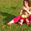 Mother with little girl on grass 2 — Stock Video #12287450
