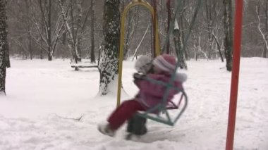 Children on winter seesaw — Stock Video