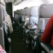 Stock Video: Salon of plane with passengers