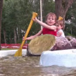 Stockvideo: Children on attraction boat