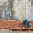 Brick worker time lapse - Stock Photo