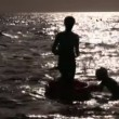 Silhouette mother with children in water — Stock Video