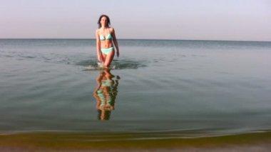 Woman walking on water — Stock Video