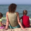 Behind mother with children sit on beach — Stock Video #12310000