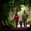 Family silhouette in plant tunnel - Stock Photo