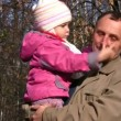 Senior with little girl in autumn park. Close-up — Stock Video