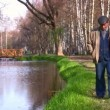 Senior walking in autumn park — Stock Video #12320053
