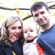 Stock Video: Parents with boy in park. faces