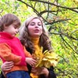 Mother with children in autumn park. — Stock Video