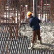 Stock Video: Flowing cement