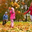 Mother with children throw autumn leaves — Stock Video
